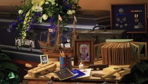 Picture and Possessions on memorial table