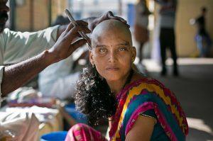 Hindu Woman Shaving Head