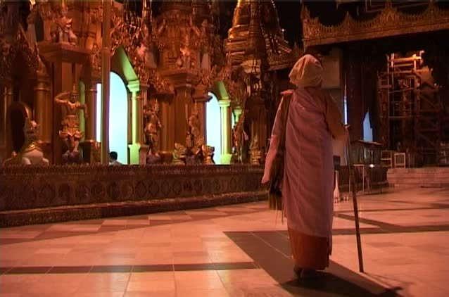 Buddhist Mourner Walking with Stick