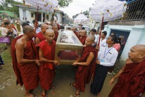 Carrying Casket to Burial