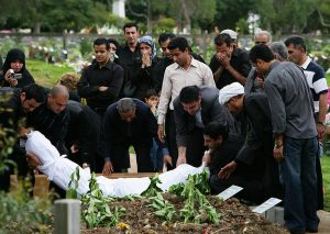 Family Places Body in Grave