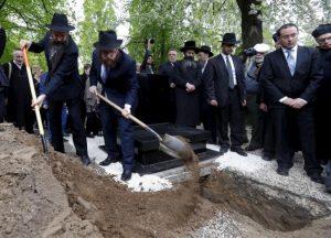 Family Filling Grave
