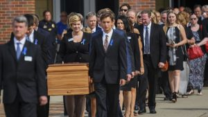 Family and Friends Escorting Casket