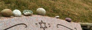 Placing Stones on Headstone